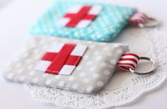 Mini first aid kit. Just the right size for smaller essentials (bandaids, travel size neosporin, etc)
