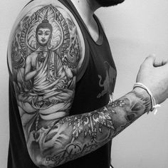 Lastly, here's another Buddha sleeve tattoo with a variety of Buddhist symbols and adornments.
