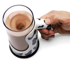 Chocolate Milk Mixing Mug (Hammacher): Pretty good gift for kids... battery-powered... child-friendly... keeps kitchens clean... 16-oz. tumbler that fits inside a Holstein-patterned holder... trigger button on the handle... simply add milk and chocolate syrup or powder to the tumbler, then hit the button... a nylon whisk quickly whips it up without creating dirty spoons, countertop spills, or the frustration of finding undissolved chocolate at the bottom of the glass... Includes sip-top…