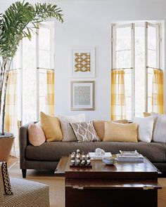 sheer curtains on tension rods/short curtain rods could be hung just on the lower part of a window, like cafe curtains, and you could still hang large decorative curtains from the ceiling.