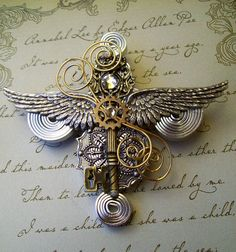 Steampunk Aviator Medal/Brooch (M13) - Silver Wings and Antique Brass Key - Coils and Gears - Swarovski Crystals. $34.00, via Etsy.