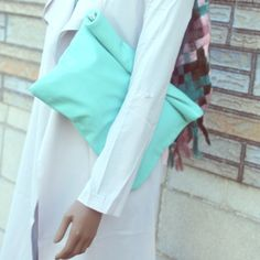 Rollover Clutch Handbag Rectangular rollover clutch handbag with hidden magnet button and zipper closure. Super cute, stylish and roomy. Synthetic fabric, fully-lined. Orange, Pink, Mint and Royal Blue..Please specify color. Bags