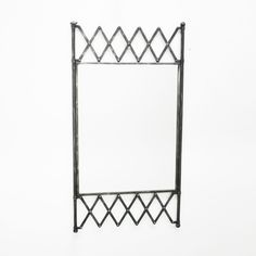 The criss-cross pattern framing our Gated Mirror adds an interesting feature to this wall mirror. It'll give your room the illusion of extra depth and will add a touch of industrial chic to your home.