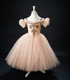 """Ballerina Costume Worn by Shirley Temple in the 1939 Film """"The Little Princess"""" The full-length gown, of most delicate pink illusion net, with four layers of very full skirts underlaid by a stiffened petticoat, has silver lame applique on the bodice and as shoulder straps, very full pouf sleeves with stiffened lining for support.  she performs a stunningly beautiful ballet dance, wearing this costume. Z"""