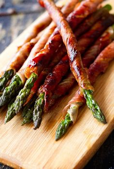 Bacon wrapped asparagus: Preheat oven to 400 Divide asparagus into bundles of 3-4 spears Wrap each in a slice of bacon In a saucepan, melt a stick of butter, 1/2 c. brown sugar, 1Tbspn soy sauce, 1/2tsp garlic salt, and 1/4 tsp black peppe and bring to a boil. Pour mix over bundles and bake until bacon looks done.