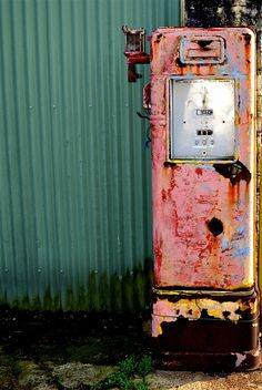 teal + faded red gas pump