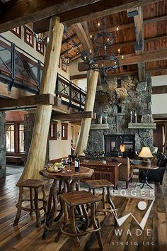 Great logs and fireplace.  timber frame architectural stock photography, timber frame patio looking out to mountain view and setting sun, private residence, yellowstone club, montana, locati architects, design associates, schlauch bottcher construction