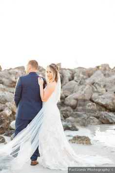 Couple photography by the rocks on the beach