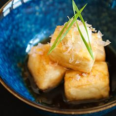 Agedashi-dofu 揚げ出し豆腐 - Tender, silky tofu with a crisp fried coating in a small pool of dashi-based broth. Grated ginger, daikon radish, and bonito flakes to serve on top. Tofu Recipes, Asian Recipes, Vegetarian Recipes, Cooking Recipes, Healthy Recipes, Tempeh, Japanese Appetizers, Tofu Dishes, Vegetarian