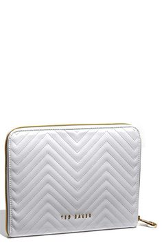 need this white patent zig zag stitch iPad case by Ted Baker (thanks to this is glamorous)