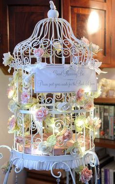 birdcage with roses and lights