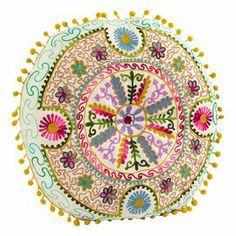 """Multicolor pillow with a tribal floral motif and pompom trim.    Product: Cushion   Construction Material: Viscose cover   Color: Multi    Features: Insert included  Dimensions: 16"""" Diameter x 5"""" D    Cleaning and Care: Spot clean only"""