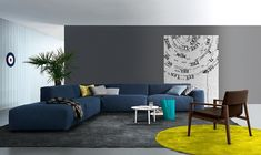 Coffee table in white stands out visually thanks to the bold couch in blue 3 Striking Color Combinations For Fall