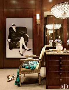 Mayer's dressing room features an Ochre chandelier, a Boo Ritson photograph, and a Porta Romana sconce