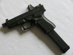 Glock with extended mag and RMR Save those thumbs & bucks w/ free shipping on this magloader I purchased mine http://www.amazon.com/shops/raeind   No more leaving the last round out because it is too hard to get in. And you will load them faster and easier, to maximize your shooting enjoyment.