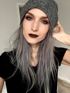 Grey hair looking great on a young pretty woman, make up colours really compliment this look
