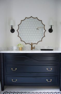 This beautiful black and white bathroom features black and white hex tiled floor as a base for a black washstand with white marble countertop which matches nicely with the gold faucet and brass scalloped mirror flanked by Longacre Sconces. Bathroom Renos, White Bathroom, Bathroom Ideas, Vanity Bathroom, Modern Bathroom, Bathroom Island, Navy Blue Bathrooms, Boy Bathroom, Bathroom Goals