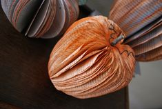 """""""Pumpkins"""" made from old books (you could easily create other fruit following the same basic steps)."""