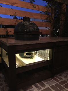 The perfect Big Green Egg table with concrete top, barn door, and built in lights   The Lowcountry Lady