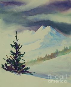 A spruce tree sits on a snowbank, with a background of majestic mountains and a distant forest.