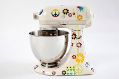 Peace and Love Kitchen Aid Brazil mixer would be fun to bake with. It is just one of the colored kitchen appliances featured. This one may not be available in America yet.