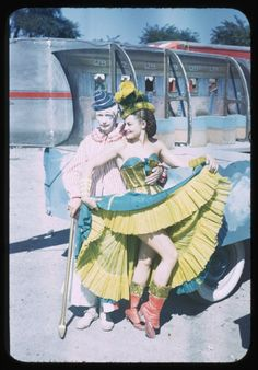 1950s circus performers in front of aluminum airstream
