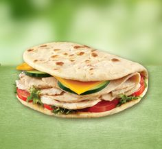1 Flatout Foldit® Artisan Flatbread 2 oz deli turkey 1 slice 2% milk American cheese 1 green lettuce leaf 2 slices tomato 2 slices cucumber Layer lettuce and tomato on one half of HG Foldit; add turkey, cucumbers and cheese. Top with favorite condiment. Fold in half.