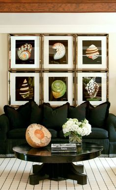 I love the shells, but I wonder about using this idea and have large silver frames with a dark mat around a picture