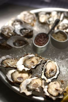 These days, you are just as likely to find raw oysters at dive bars and cocktail lounges as you are at steakhouses or seafood restaurants. They're fresh, cheap and abundant in the fall. Bar hoppers pretty much expect bivalves this...
