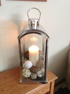 Lantern filled with decorative balls - cheap, easy, pretty, perfect! #summersolstice #decor