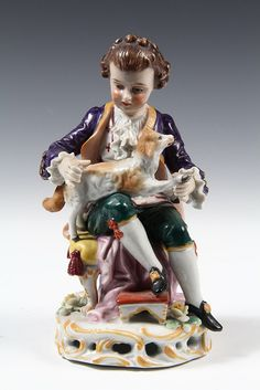 GERMAN PORCELAIN FIGURINE - Early 19th c German figure of a Boy Seated with a Lamb in His Lap, indistinct blue mark on underside