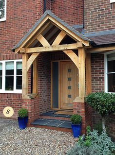 Traditional oak porch with oak front door Oak Front Door, Front Door Porch, Porch Doors, Front Porch Design, Porch Designs, Front Porches, House With Porch, House Front, Door Canopy Porch