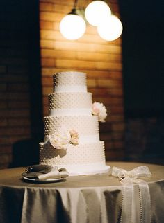 Four tiered polka dot wedding cake!  Photo: Olivia Leigh Photographie.
