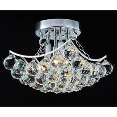 This gorgeous flush-mount chandelier will give your dining room, kitchen, or entryway an elegant look. It has four lights, 36 clear crystals, and a chrome finish. The chandelier requires four 25- to 40-watt bulbs, which are sold separately.