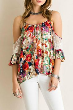 """Beautiful floral print cold shoulder top featuring lace detail on the sleeves and adjustable straps. Perfect date night top paired with white skinnies and heels or make it casual with a pair of shorts and sandals for a day at the park! Top fits loose, but is true to size.    Medium measures 20.5"""" across chest and 24.5"""" shoulder to hem.   Ravishing Floral Top by Entro. Clothing - Tops South Carolina"""