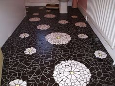 Mosaiced bathroom floor, worked by Susanne using cut floor tiles. wow that is amazing!