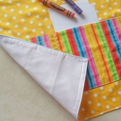 """Kids Crayon Apron yellow, childs polka dots apron, kids craft art play coloring apron, girls & boys lined cotton apron, candy stripes pocket. """"Let's be creative!"""" Perfect as a craft apron for girls & boys who adore coloring in. They come in white spots on a yellow background for main body &"""