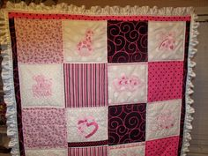 A sweet pink, black & white baby girl quilt with 10 *pink* embroideried squares