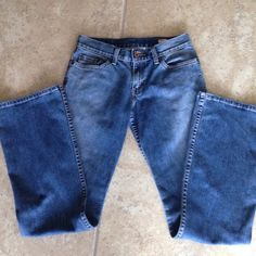 Levi jeans Levi boot cut jeans  purchased at Nordstrom years ago. They are 96.5 cotton  3.5 spandex great stretch !! Measurements are waist lying flat 14 1/2 inches , rise 8 1/2  inseam 31 1/2 . Worn a few times , excellent condition!!! Levi's Jeans Boot Cut