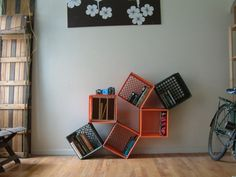 Use zip ties to arrange your milk crates in a pattern along the wall.