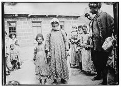 Photograph shows refugees, possibly Armenians, leaving hospital. 1918