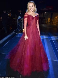 Princess perfect! Miley Cyrus dazzled in a ruby red Zac Posen gown during a performance with the legendary Elton John during Sunday's Grammy Awards in NYC