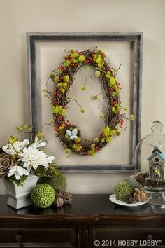 This beautiful woodland wonder is a cinch to create! Start with one of our natural oval wreaths and randomly nestle bits of reindeer moss in and around the vines, securing with hot glue. For a punch of color, add whimsical flocked balls and berries.
