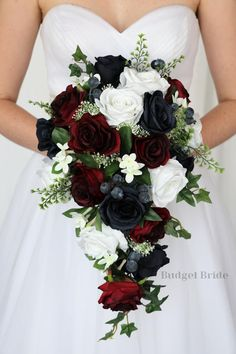 Cascading brides bouquet made with navy blue roses, wine roses white roses accented with stephanotis and greenery Winter Themed Wedding, Winter Wedding Bouquets, Christmas Wedding Flowers, Cascading Bridal Bouquets, Bride Bouquets, Flower Bouquet Wedding, Burgundy And Grey Wedding, Burgundy Wedding Flowers, Navy Flowers