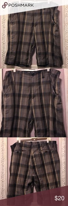 Men's Arizona Jean Co. Plaid Shorts Men's Arizona Jean Co. Plaid Shorts Size 40. Flat front. Shades of dark khaki, black, dark brown. 100% cotton. Lightweight material. No holes or stains. 12 inch inseam. Smoke free home. Arizona Jean Company Shorts Flat Front