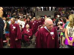 """▶ Elon University, the """"Long Maroon Line"""" - Fall 2013 Convocation featured for the first time the """"Long Maroon Line."""" One hundred and twenty-five alumni, representing each year in Elon University's history, processed into Alumni Gym as part of the school's quasquicentennial celebration."""