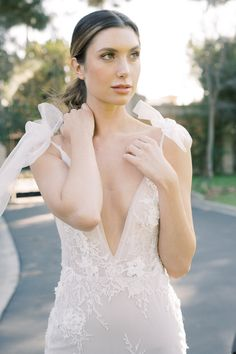 "From the editorial ""How to Add Old World Charm to Your Outdoor Garden Wedding."" How pretty are the shoulder bows on this gown?! Sharing more inspo from this gorgeous wedding shoot over on SMP!  Photography: @lucymunozphotography Gown: @berta  #weddingdress #weddinggown #bridalfashion #brideinspiration #bertabride"
