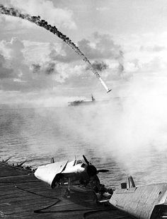 A Japanese fighter plane on a kamikaze mission is shot down by anit-aircraft guns on an aircraft carrier. From: NEMESIS: THE BATTLE FOR JAPAN 1944-45 by Max Hastings, published by HarperPress