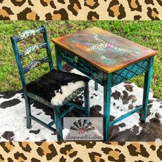 Whippoorwill Customs used many colors to redo this piece! Rustic Red, Copper & Iron Patina paints, Colonial Mustard, Florida Orange on the top. The Cow skull is Burlap, Chocolate and Midnight Sky. The base of the desk and the chair is Pure Ocean layered with Midnight Sky and heavy black glazing for a worn turquoise look. Metallic paints were used as the accents! #paintedfurniture #eccentric #dixiebellepaint #pureocean #midnightsky