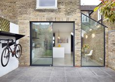 Rise Design Studio adds glass extension to London house Rise Design Studio has added a glazed extension to the rear of a London house, creating a light-filled kitchen and dining room that opens up to the garden